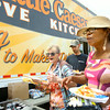 6-17-14   --- Little Caesars set up a truck giving pizza away at the Kokomo Rescue Mission on Tuesday. Tamara Huizer and Debra Watters go through the line for pizza, side and snack in the parking lot. --<br />   Tim Bath | Kokomo Tribune