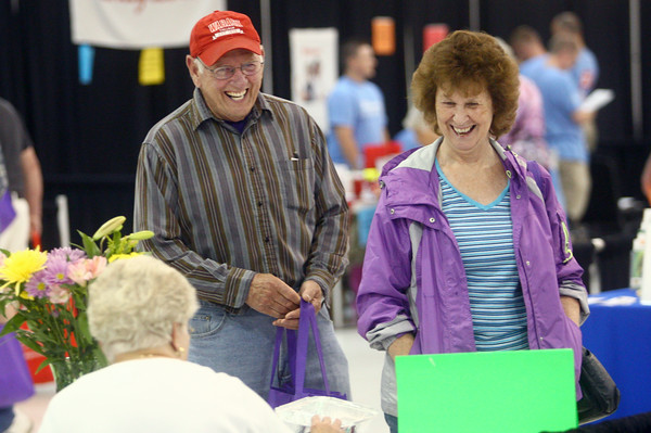 6-26-14<br /> Senior Expo<br /> Michael and Margaret McKinney laugh as they walk through the booths set up at the Senior Expo on Wednesday.<br /> Kelly Lafferty | Kokomo Tribune