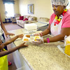 6-17-14   --- Summer free lunch program hosted by Carver Community Center drawing kids like Shy Brown, 4, who is handed a tray of food by LaDonna Johnson. --<br />   Tim Bath | Kokomo Tribune
