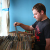 6-20-14<br /> American Dream HiFi<br /> Adam Kinney looks through the records at American Dream HiFi, located on Center Road.<br /> Kelly Lafferty | Kokomo Tribune