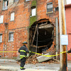 6-4-14   --- Kokomo firefighters secure the area behind the Turner Building sometimes more recently called the Barko building. --<br />   Tim Bath | Kokomo Tribune