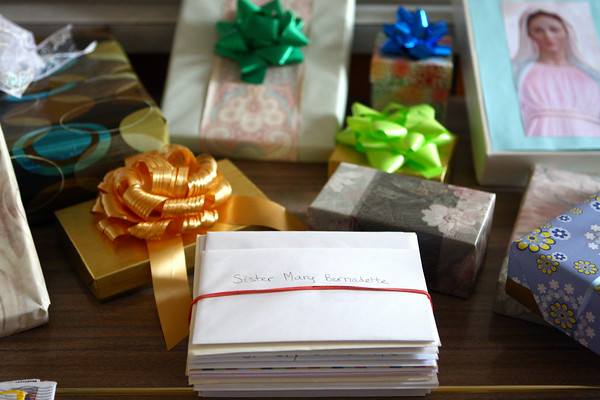6-27-14<br /> 100-year-old nun<br /> Gifts and stacks of cards fill a table at the Poor Clares Monastery for Sister Bernadette, who is celebrating her 100th birthday.<br /> Kelly Lafferty | Kokomo Tribune