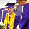 6-7-14<br /> Northwestern Graduation<br /> David Schaaf and Erick Vas light a candle on stage in remembrance of Kalin Storie, a classmate who was killed in a 2013 car accident.<br /> Kelly Lafferty | Kokomo Tribune