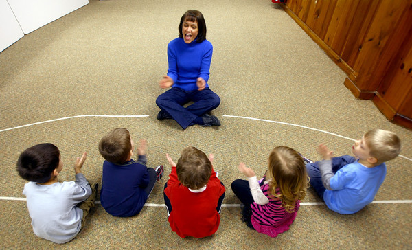 3-4-13<br /> Kaye Jean Swinehart teaches Kindermusik at Highland Park Church. Swinehart will be moving to Michigan. Starting off the 4 year-old's session with a song<br /> KT photo   Tim Bath