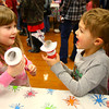 3-2-13<br /> Kokomo Howard County Public Library south branch Read Across America Day & Celebration. Jocelyn Jeffers, 4, and Noel Wittenbach, 6, playing with the puppets that they made.<br /> KT photo | Tim Bath
