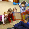 3-4-13<br /> Kaye Jean Swinehart teaches Kindermusik at Highland Park Church. Swinehart will be moving to Michigan. Reading a book about the world to Annabella Beadham, Charlie Maurick, Connor Clouser, Dawson Floyd and Eli Carter.<br /> KT photo | Tim Bath