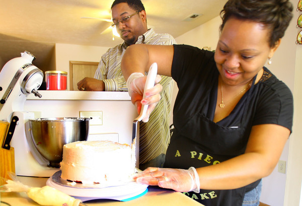 2-25-14   --- Lucrecia and Darius Olive as Lucretia makes a cake for her business A Piece of Cake. She started her business through Family Self Sufficiency Porgram.  -- <br />   KT photo | Tim Bath