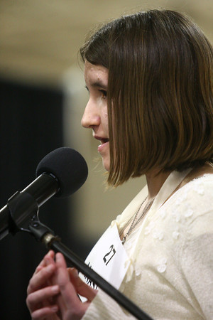 3-18-14<br /> Spelling Bee<br /> Maconaquah Elementary School fifth grader Anastasia Spahr spells her final word to win the Spelling Bee on Tuesday night.<br /> KT photo   Kelly Lafferty