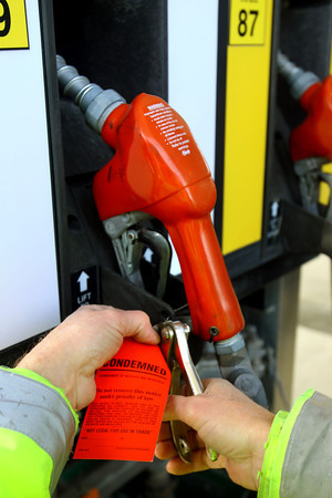 3-17-14   --- Gary Gist checks the pumps for accuracy at a gas station in Howard County. The pump failed due to a faulty check valve.  -- <br />   KT photo   Tim Bath