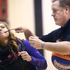 """3-19-14<br /> Jim """"Basketball"""" Jones anti-bullying<br /> Jim """"Basketball"""" Jones shows how he is going to spin and balance a basketball on a pen in Kendra Perkins' mouth at Western High School.<br /> KT photo 