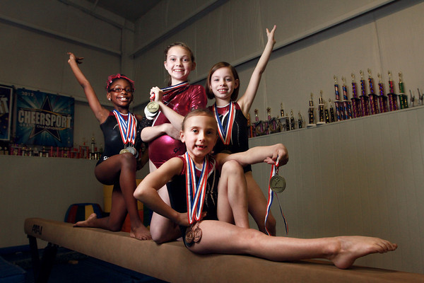 3-12-14<br /> From left: Nevaeh Andrews, Camber Fillenwarth, Sophi Adams, and Samara Sims (front) of Kokomo Flipsters medaled at a recent state tournament.<br /> KT photo | Kelly Lafferty