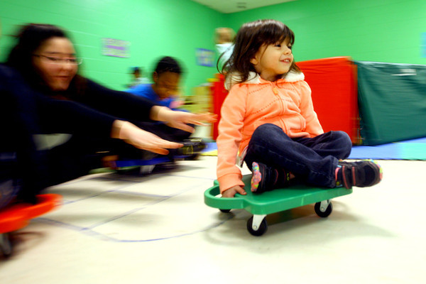 3-4-14   --- Bona Vista Daycare. Gabriella Dorbin gets a push on a scooter while in gym.  -- <br />   KT photo   Tim Bath
