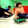 3-4-14   --- Bona Vista Daycare. Gabriella Dorbin gets a push on a scooter while in gym.  -- <br />   KT photo | Tim Bath