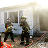 3-26-14   --- Kokomo firefighters battle a house fire at 517 Edgewater Drive in Kokomo on Wednesday afternoon. The fire started in the rear with noone in the house. -- <br />   KT photo | Tim Bath