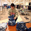 3-6-14<br /> Reorganizing JC Penney<br /> Haley Martin organizes the jean display at JC Penney in Kokomo before the store re-opens its doors.<br /> KT photo | Kelly Lafferty