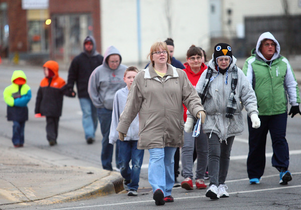 3-22-14<br /> Walk a Mile<br /> Walkers make their way north on Washington Street from the Kokomo Rescue Mission to the Open Arms shelter on Main Street during Walk a Mile In My Shoes, a fundraiser forthe Open Arms Homeless Women Shelter.<br /> KT photo | Kelly Lafferty