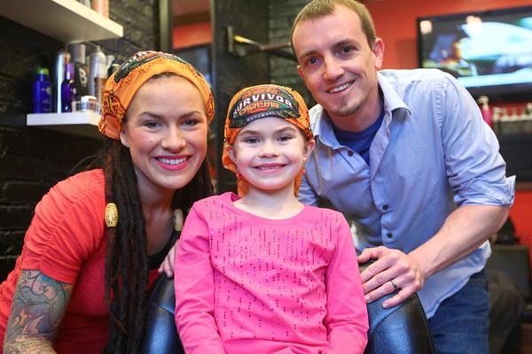 3-29-14<br /> Lindsey Ogle<br /> Lindsey Ogle and her daughter Laney, and husband Dustin.<br /> KT photo | Kelly Lafferty