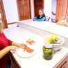 2-26-14   --- Kimberly Earl making lunch for her kids. Her daughter Whitney, 9, is diabetic and allergic to gluten while son Collin, 7, is allergic to peanuts.  -- <br />   KT photo | Tim Bath