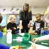 3-18-14<br /> Bilingual class at Lafayette Park Elementary<br /> Andrew Barker gives Spanish teacher Nicole Geary a high five after he and Brazyl Collins complete an activity, while Emily Williams and Mia Burns work on their activity at the same table.<br /> KT photo | Kelly Lafferty