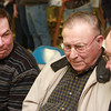 3-11-14<br /> Farmland auction at Kokomo Shrine Club<br /> Charles Spangler (center) speaks with Curt Silvey (left) and Mike Spangler (right) about making a bid on farmland for auction at the Kokomo Shrine Club.<br /> KT photo | Kelly Lafferty