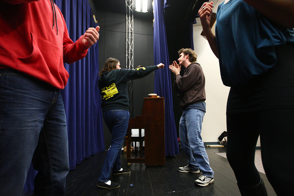 3-25-14<br /> Stage Combat at IUK<br /> Zoe Blackwell practices punching Shane Evans during IUK's stage combat workshop.<br /> KT photo | Kelly Lafferty