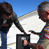 3-6-14<br /> Eagle Scout Bat box<br /> Eagle Scout Tyler Solis and his dad Manuel Solis put a Batman sticker on one of the bat boxes Tyler made and will donate to Kokomo to control mosquito populations in the parks.<br /> KT photo | Kelly Lafferty