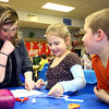 3-18-14<br /> Bilingual class at Lafayette Park Elementary<br /> Spanish teacher Nicole Geary helps Lafayette Park first graders Isabella Lee and Jayden Kwiek with an activity.<br /> KT photo   Kelly Lafferty