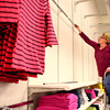 3-6-14<br /> Reorganizing JC Penney<br /> Shelly Ragon works on building the wall display to hang clothing in Kokomo's JC Penney before the store re-opening.<br /> KT photo | Kelly Lafferty