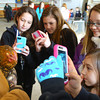 3-18-14   --- Ag Day at the Howard County Fair grounds. Eastern 5th graders Lacey Biesecker, Grace Cowsert, Kat Cauthern and Deanna Ayers get a closeup look at a chicken. -- <br />   KT photo | Tim Bath