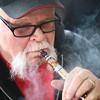 3-28-14<br /> Kokomo Pure Vapors<br /> Jeff Lamberson uses an e-cigarette in his shop, Kokomo Pure Vapors.<br /> KT photo   Kelly Lafferty