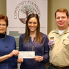 3-13-14   --- Hilda Burns, President of the Community Foundation of Howard County with Katie Thatcher, wife of Joe Thatcher, and Chris Mehaffey from the Sagamore Council, Boy Scouts of America as Katie presents a check through the foundation to the Boy Scouts.  -- <br />   KT photo | Tim Bath