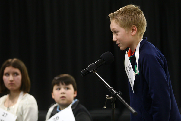 3-18-14<br /> Spelling Bee<br /> Parker Wilburn of Lincoln Middle School spells a word during Tuesday night's Spelling Bee. Wilburn came in fourth.<br /> KT photo | Kelly Lafferty