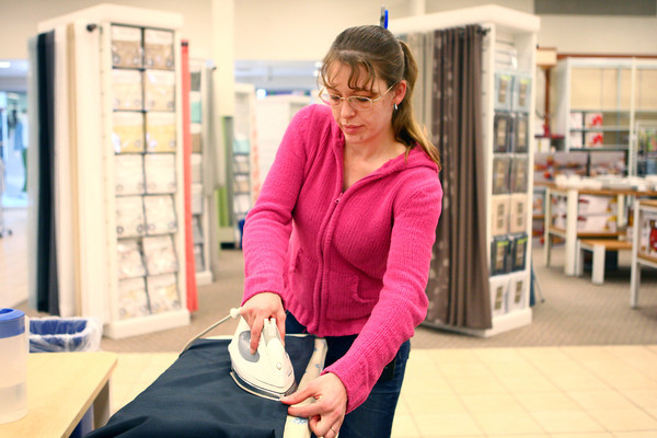 3-6-14<br /> Reorganizing JC Penney<br /> Melissa Heflin irons drapes to be hung in Kokomo's JC Penney's display before the store re-opening.<br /> KT photo | Kelly Lafferty
