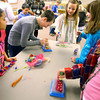 3-13-14   --- Wallace students make bracelets from recycled wool. Kids including Gavin Huffman joke around while doing the project.  -- <br />   KT photo | Tim Bath