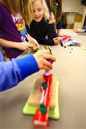 3-13-14   --- Wallace students make bracelets from recycled wool. Maisy Meyers watches as Brooke Hughes works on her project. -- <br />   KT photo | Tim Bath
