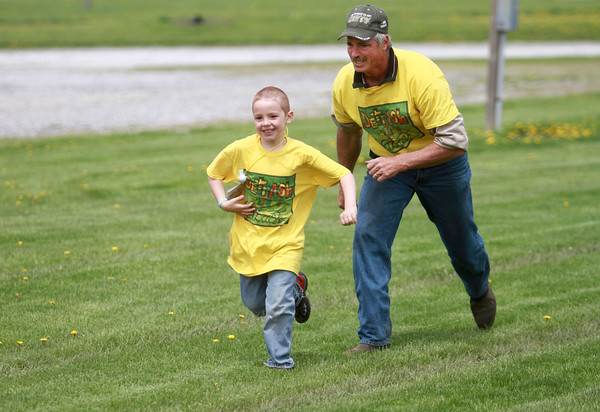 5-4-13<br /> Family Fun day at the fairgrounds<br /> Logan Hook races to beat Gail Brovont during a race at Family Fun Day at the Howard County Fairgrounds.<br /> KT photo   Kelly Lafferty