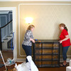 5-2-13<br /> Designer showhome<br /> Sheryl Dillman and Marilyn Berry move a dresser in the living room of the Designers' Showhome on Thursday.<br /> KT photo | Kelly Lafferty