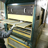 4-28-14   --- Beck's Hybrids located in Hamilton county will be expanding and creating more jobs. Francisco Tevalan pulls cleaning screens from a machine that is used to seperate seeds from stalks or any other matter that ended up with the seeds.  -- <br />   Tim Bath | Kokomo Tribune