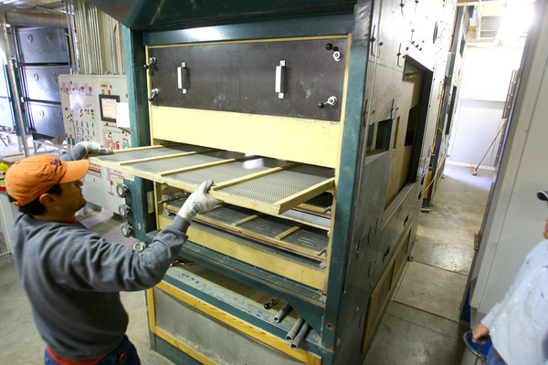 4-28-14   --- Beck's Hybrids located in Hamilton county will be expanding and creating more jobs. Francisco Tevalan pulls cleaning screens from a machine that is used to seperate seeds from stalks or any other matter that ended up with the seeds.  -- <br />   Tim Bath   Kokomo Tribune
