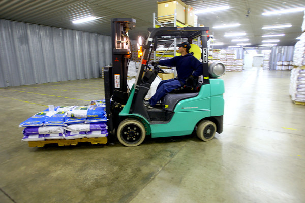 4-28-14   --- Beck's Hybrids located in Hamilton county will be expanding and creating more jobs. Jeff Humburg moving seed through the warehouse. -- <br />   Tim Bath | Kokomo Tribune