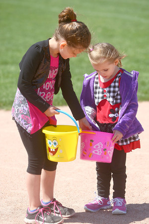 4-19-14<br /> Easter Egg Hunt at Northwest Park<br /> 6-year-old Lydea Groves shares some of her Easter Eggs she found  at Northwest Park with her friend, 4-year-old Rylie Hindman, since Riley didn't get any.<br /> Kelly Lafferty | Kokomo Tribune