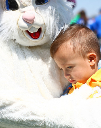 4-19-14<br /> Easter Egg Hunt at Northwest Park<br /> 22-month-old Aydan Short gives the Easter bunny a hug before the start of the Easter egg hunt at Northwest Park on Saturday.<br /> Kelly Lafferty | Kokomo Tribune