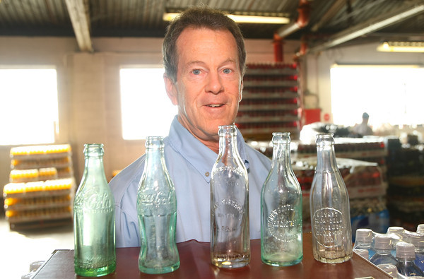 11-6-12<br /> Craig Severns with some of the beverage bottles that he has collected over the years. Craigs family has owned Coke bottling and distributors in the area since 1935.<br /> KT photo | Tim Bath