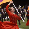 11-3-12<br /> Lewis Cass Marching band comp<br /> Brittany Wright of the Lewis Cass colorguard smiles as she performs with the band during the Lewis Cass peformance at the State Marching Band Finals at Lucas Oil Stadium on Saturday.<br /> KT photo | Kelly Lafferty