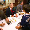 11-17-12<br /> Joe Thatcher, Dick Enberg and Nolan Sanburn signing autographs at the Joe Thatcher annual charity dinner and auction. Dick Enberg talking with Weston Gingerich, 10, while getting his autograph.<br /> KT photo | Tim Bath