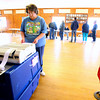 11-6-12<br /> Election taking place for precinct Honey Creek 1 at Russiaville Lions Club on Tuesday. Diane Carman places her ballot in the voting counter after casting her vote.<br /> KT photo | Tim Bath