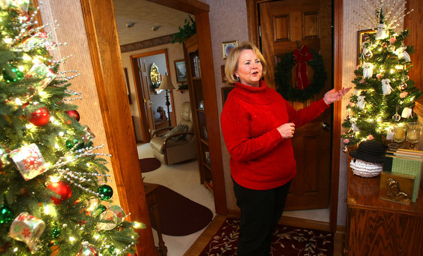 11-20-12<br /> Nancy Wyant with some of the Christmas trees that she decorates in her house.<br /> KT photo | Tim Bath