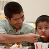11-22-12<br /> Thanksgiving Dinner at Grace United Methodist Church<br /> Moises Cardona feeds his 4-year-old son Isaiah Cardona cranberry sauce during the Thanksgiving Dinner at Grace United Methodist Church on Thursday.<br /> KT photo | Kelly Lafferty