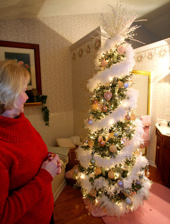 11-20-12<br /> Nancy Wyant with some of the Christmas trees that she decorates in her house.<br /> Tree in master bathroom.<br /> KT photo | Tim Bath