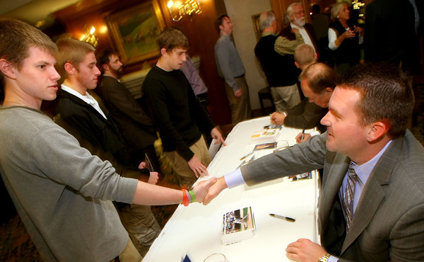 11-17-12<br /> Joe Thatcher, Dick Enberg and Nolan Sanburn signing autographs at the Joe Thatcher annual charity dinner and auction. Ryan Brinkworth shaking hands with Joe Thatcher.<br /> KT photo | Tim Bath
